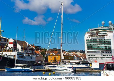 Pier With Boats And Ships In Stavanger, Norway. Typical Scandinavian Houses On The Beach.