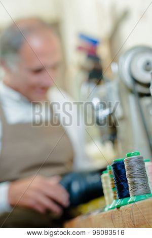 Cobbler in his well equipped workshop