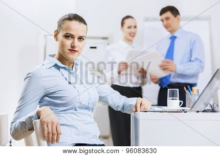 Businessman and businesswoman in office having conversation