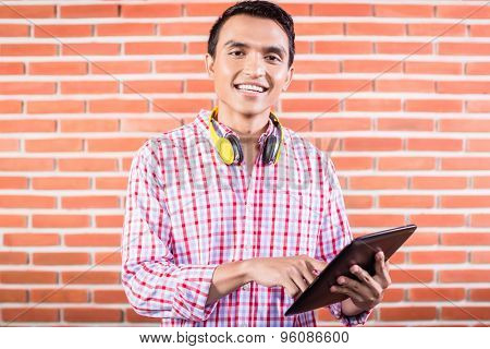 Indian college student with tablet computer