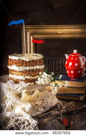 Naked Layer Cake , Teapot, Vintage Tableware And Books On Wooden Table.