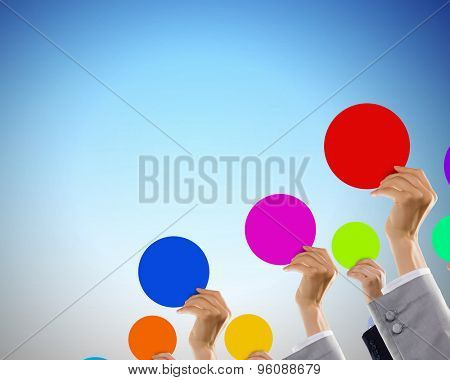 Crowd of businesspeople lifting up hands with conceptual cards