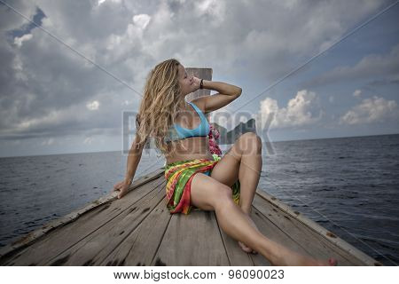 Young Woman In Bikini On A Boat