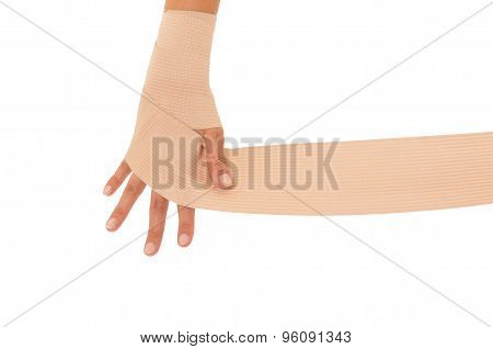 Female hand with fingers spread and bandage applied