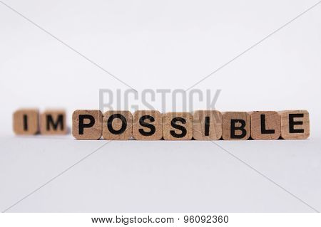 motivation text on wooden cubes, isolated on white background