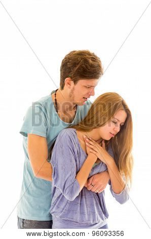 Couple demonstrating first aid procedure for abdominal thrusts, Heimlich Manoeuvre or Maneuver to tr