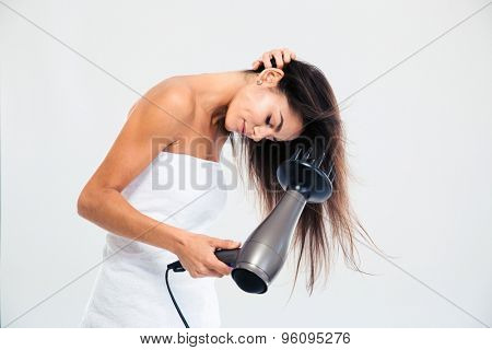 Young woman in towel drying her hair isolated on a white background