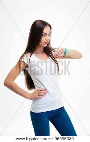 Beautiful woman looking on wristwatch isolated on a white background