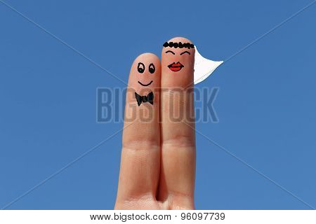 Married, Two Fingers Painted With Sky At Background