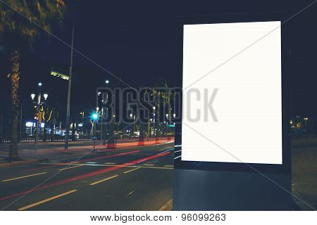 Vertical blank billboard  for your text message or content advertising in the night city street