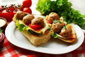 picture of meatball  - Meatball Sandwiches on wooden table background - JPG