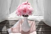 picture of chrysanthemum  - Beautiful chrysanthemums in vase on fabric background - JPG