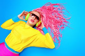 pic of dreadlock  - Ultra trendy DJ party girl in bright clothes - JPG