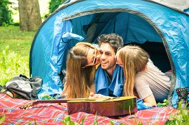 picture of flirt  - Group of best friends having fun camping together  - JPG