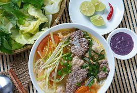 stock photo of shrimp  - Vietnamese food bun rieu a famous dish of Vietnam raw material as tomato crab pork meat shrimp salad scallion egg vegetable shrimp paste bunrieu is Viet Nam special eating - JPG