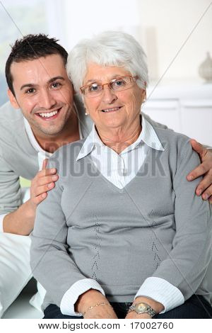 Closeup of elderly woman with young man