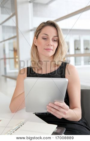 Businesswoman in the office working on electronic tab