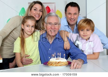 Family celebrating grandfather's birthday