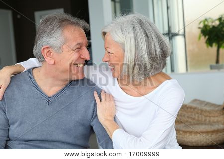 Happy senior couple looking at each other
