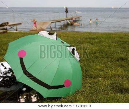 Smiling And Happy Green Umbrella