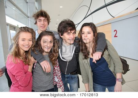Group of classmates standing in school entrance hall