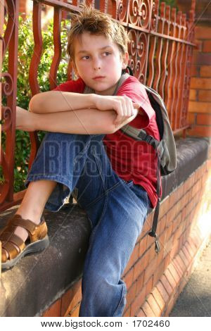 Boy With Schoolbag Slung Over Shoulder