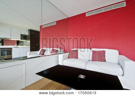 suite apartment in red with reflection of kitchen in the mirror
