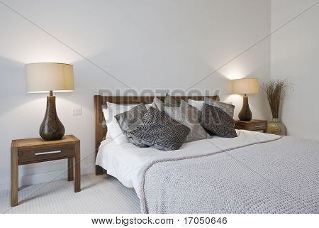 bedroom with king size bed bedside tables and reading lamp