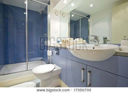 modern blue bathroom with shower cabin