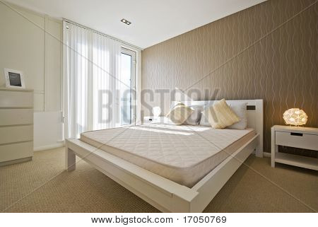 modern designe double bedroom in white with brown wave patterned wall paper