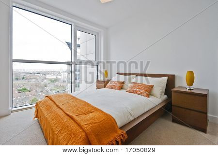 bedroom with double bed and orange decoration