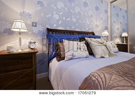 luxury bedroom detail with flower pattern wallpaper