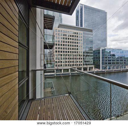 balcony of a contemporary development with city and dock view