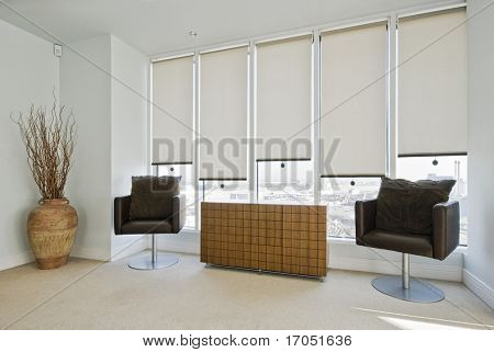 sitting area in a contemporary bedroom of a duplex apartment