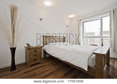 modern bedroom with double bed and bedside table