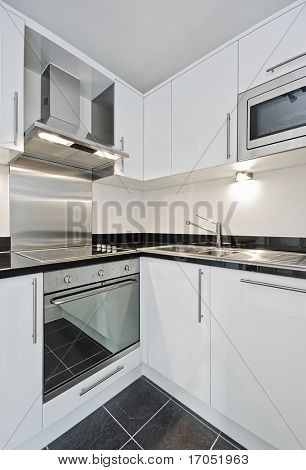 modern kitchen in white whit granite worktop