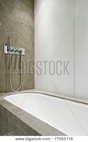 modern designer marble bath tub with slim line shower attachment
