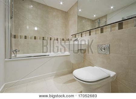 modern bathroom detail with white suite and floor to ceiling tiles