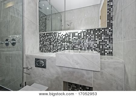 modern en-suite bathroom with marble sink and mosaic tiles