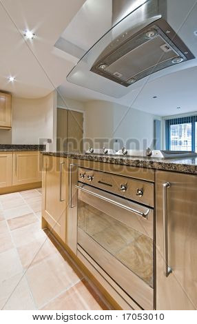 detail shot of a modern kitchen isle with oven and hob