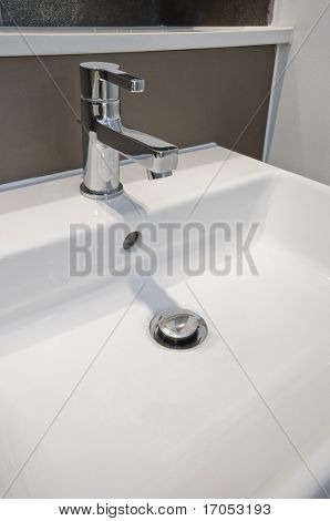 detail of a modern designer hand wash basin