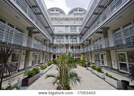 atrium of a modern multi-storey residential development