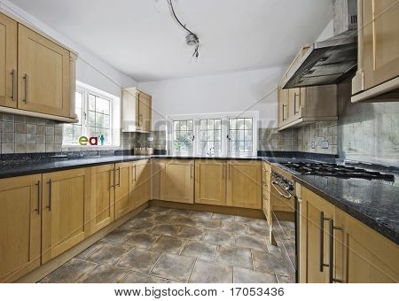 massive cottage style kitchen in wooden finish and granite worktop