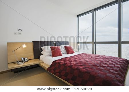 amazing luxury bedroom with floor to ceiling windows