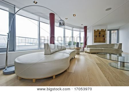 luxury penthouse living room with massive leather sofas