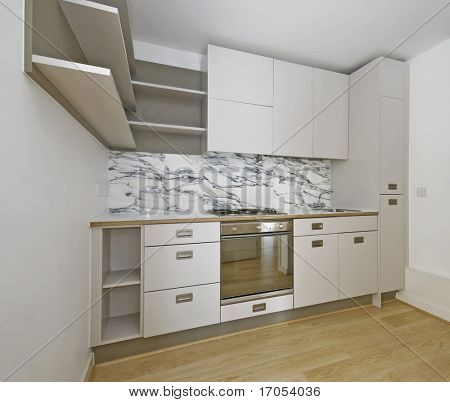 modern corner shape kitchen unit in beige color