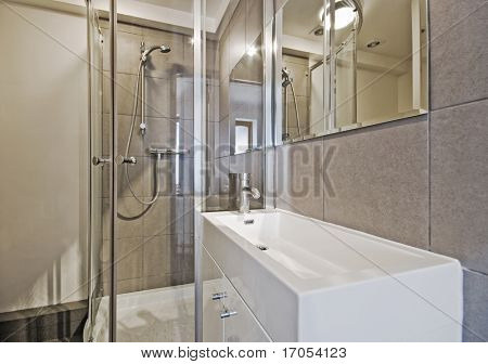 modern en-suite bathroom with shower cabin and box shape sink
