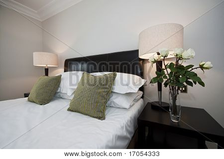 bedroom detail with double bed and bedside tables