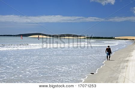 tourist walking on the beach of the beautiful fisherman village of Jericoacoara in ceara state brazil