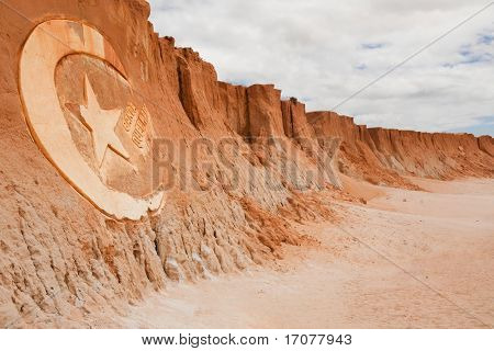 carving sign in Red beach of Canoa quebrada in ceara state brazil